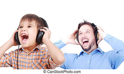 Man, very cute child and music - young man listenin to music...