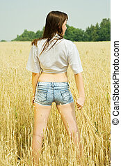 Girl at cereals field - Girl with wheat ears at cereals...