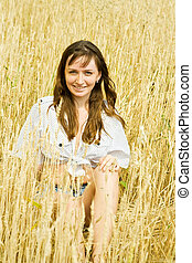 girl at cereals field - Sitting girl at cereals field in...