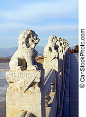 Stone lion sculpture on the 17-arch bridge in the Summer...
