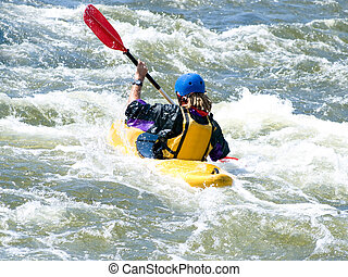kayaker - a shot of the kayaker on the rough water