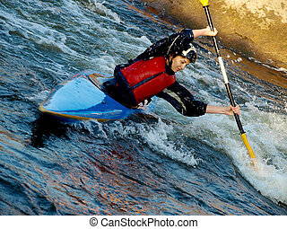 kayaker - image of the kayaker with an oar on the water...