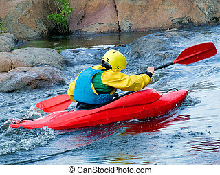 kayaker - image of the kayaker with an oar on the water