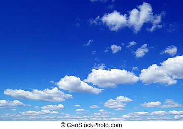 blue sky - blue sky is covered by white fluffy clouds...