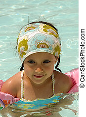 Child in pool - Happy child in a swimming pool