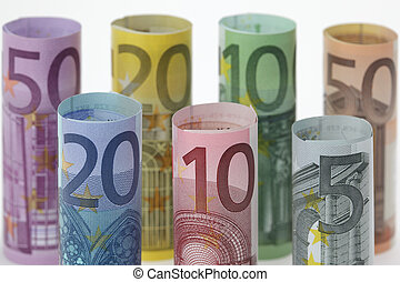 Rolled up Euro bills on white background