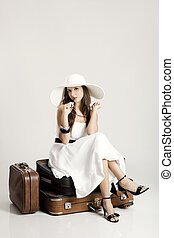 Beautiful fashionable woman - Fashion woman sitting over her...