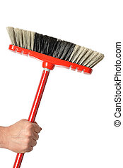 Hand with Red Broom - Hand holding red broom isolated on...