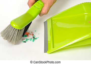 Brush and Dustpan - Green brush and dustpan with some...