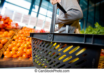 Grocery Shopping - A detail of a man shopping for fruits and...