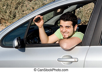 young man with key to new or rental car