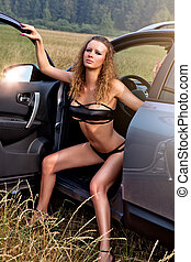 Young sexy woman with car