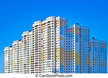 New apartment building on sky background.