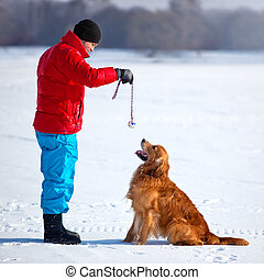 Young man playing with dog
