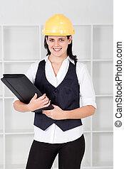 female architect holding files