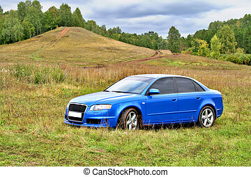 Blue car - A blue car at countryside