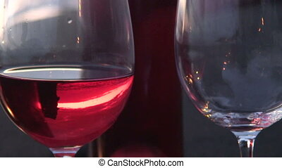 Wine on the beach - Two glass of red wine get pouring on a...