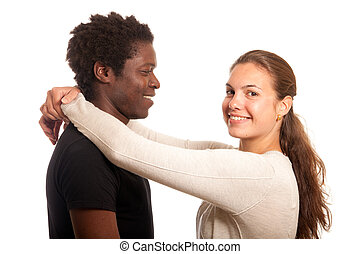 young couple - a multiracial couple posing together holding...