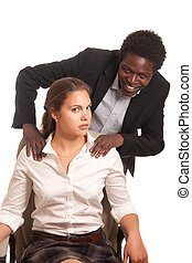 sexual harassment - young woman beeing touched by a fellow...
