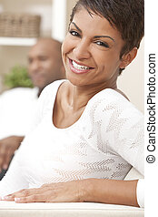 Happy African American Woman Couple Sitting At Home