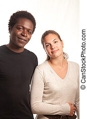 young couple posing - a multiracial couple posing together...