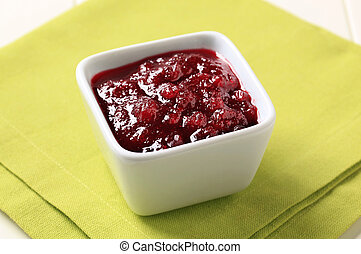 Cranberry sauce in a small square dish