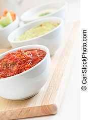 Salsa Guacamole and Hummus Dips - Close up of a bowl of...