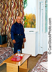 elderly man in the room
