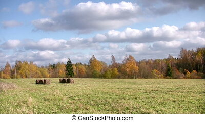 Autumn landscape - Autumn timelapse with clouds and hay...