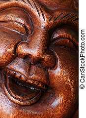 Portrait of Wooden Buddha Statue - Close up to the face of...