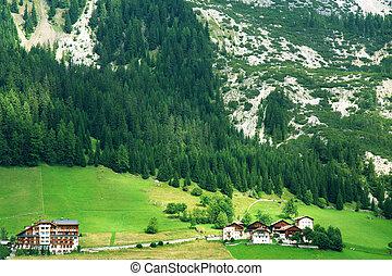 Alpine valley, Dolomites - village in alpine valley,...