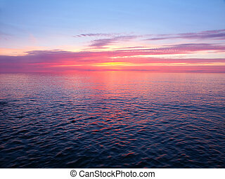 Lake Superior Sunset - Beautiful pink colors reflect off...