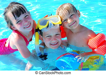 Kids in Pool - Happy children swimming together in a pool