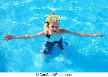 Happy snorkeling boy in pool