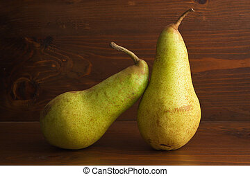 Pears - Two pers on a wooden table