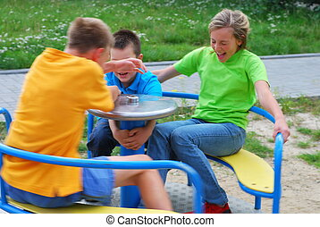 Kids on playground - A view of three kids having fun...