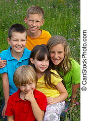 Five happy children - A view of a group of five happy...