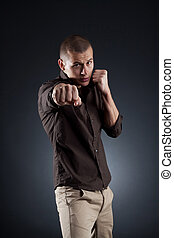 young fashion man in a fight position