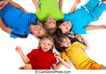 Children Having Fun - A group of children lie down with...