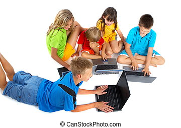Children With Laptops - A group of children huddle together...