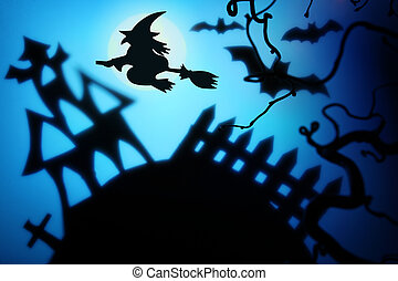 Halloween night with witch,bat and house