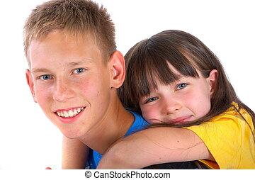 Siblings - A portrait of a pair of loving siblings. The...