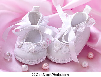 Handmade white baby booties with pearls