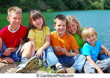 Children at the Lake - Five huddled smiling, happy loving...