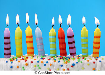 Nine birthday candles on blue background