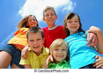 Five happy kids - A view looking upwards at five, happy,...