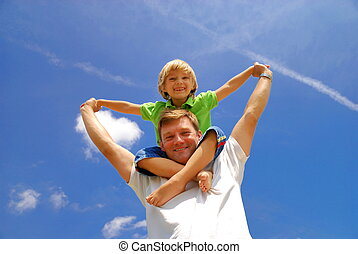 Fun with child - A man has some fun with his child, perching...