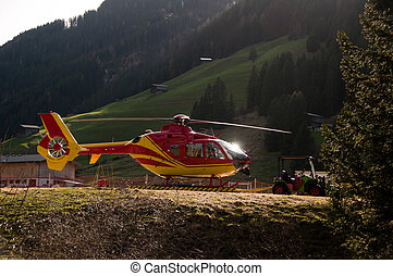 Grounded Yellow and Red Helicopter At Hangar - Side Of...