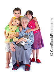 Grandmother and grandchildren - A grandmother poses happily...