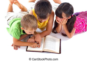 Children reading book - Group of children reading book...